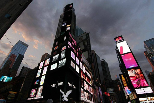 "Times Square photo on billboard of ""Lighter Than Air"" on the bottom row, 2nd from the left."