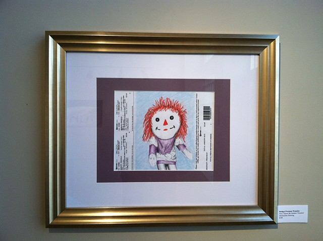 Raggedy Ann image sandwiched between lines of prescription information.