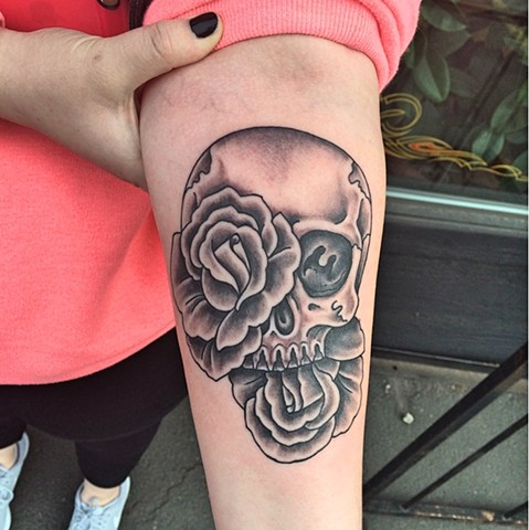 Skull and rose tattoo by Dirk Spece at Gold Standard Tattoo in Bend, OR.