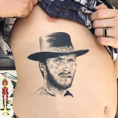 Clint Eastwood tattoo by Dirk Spece at Gold Standard Tattoo in Bend, OR.