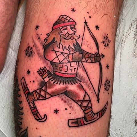 Skiing viking tattoo by Kc Carew at Gold Standard Tattoo in Bend, OR.
