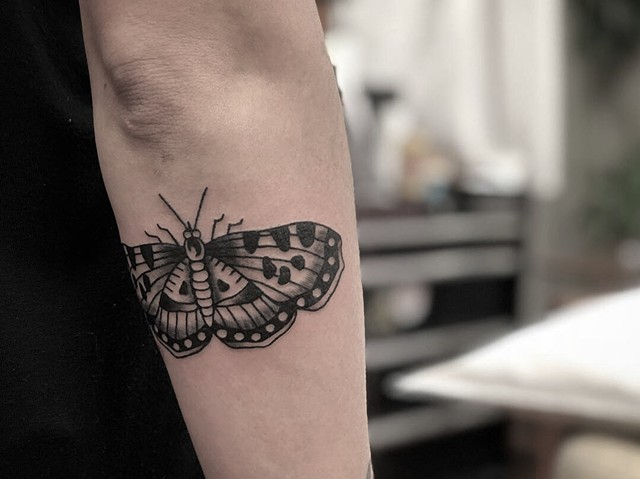 Black moth tattoo by Kc Carew in Bend, Oregon