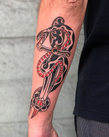 Snake & dagger tattoo by Kc Carew at Gold Standard Tattoo in Bend, Oregon