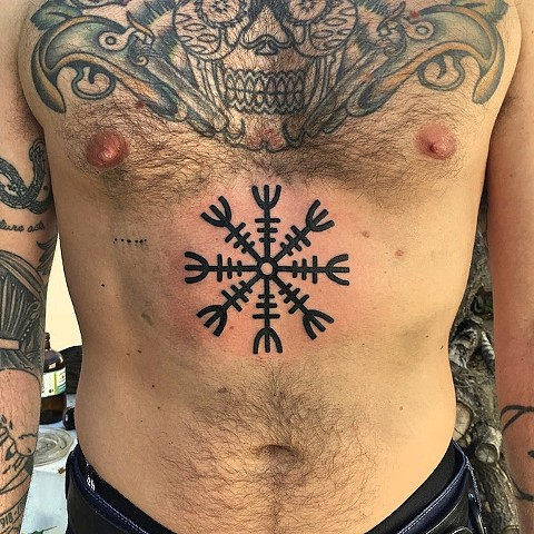 Norse compass tattoo by Kc Carew at Gold Standard Tattoo in Bend, OR.
