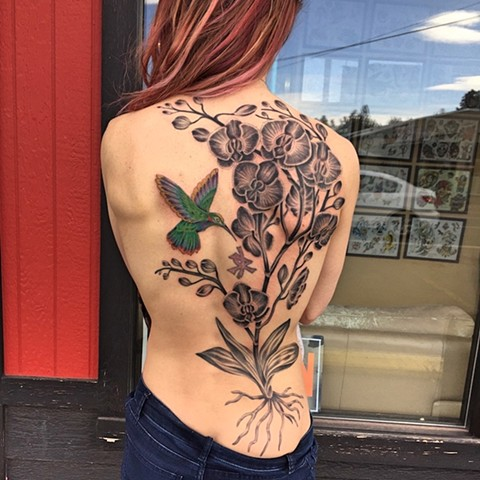 Humming bird and flowers tattoo by Dirk Spece at Gold Standard Tattoo in Bend, OR.