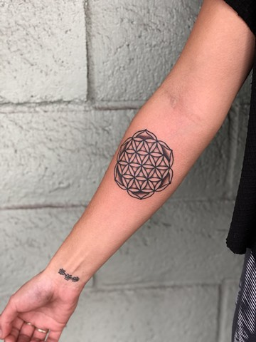 Black mandala tattoo by Kc Carew at Gold Standard Tattoo in Bend, Oregon