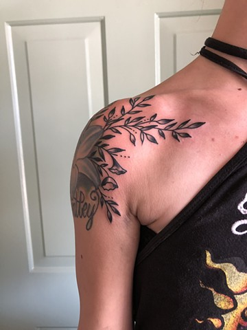 Shoulder flower & leaf tattoo by Kc Carew at Gold Standard Tattoo in Bend, Oregon