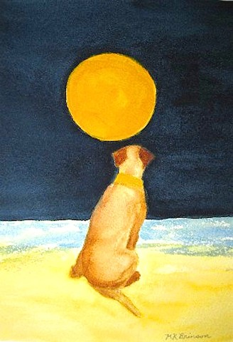 A yellow Labrador retriever sits on the beach while looking at a full moon.