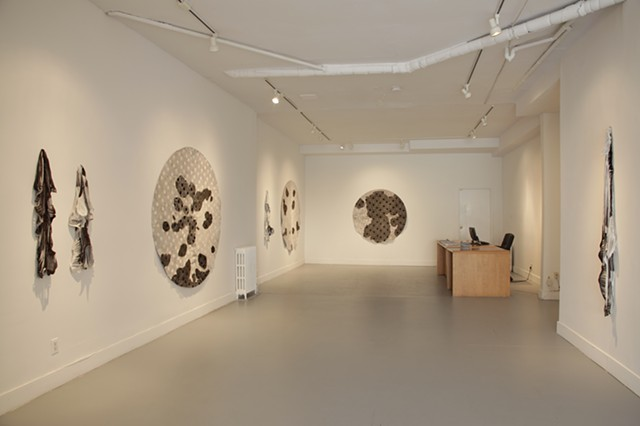 Art installation of shaved and cut cowhides and calfskins
