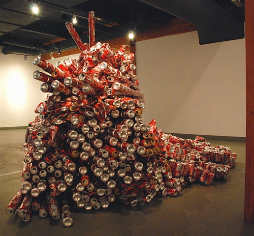 Sculpture of mountain made out of reclaimed coke cans and packing tape