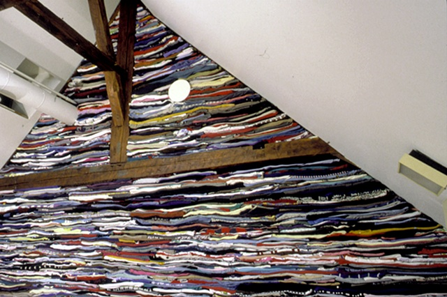 Art installation wall in textile museum made of used clothing
