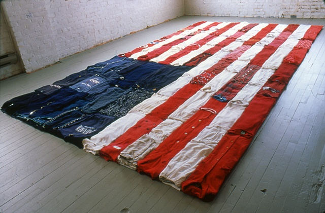 Folded used clothing American flag installation in Salvation Army Thrift Store