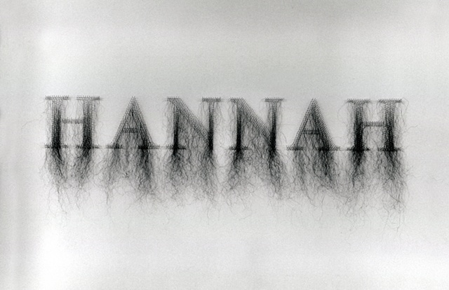 Art installaiton of names made with human hair and straight pins