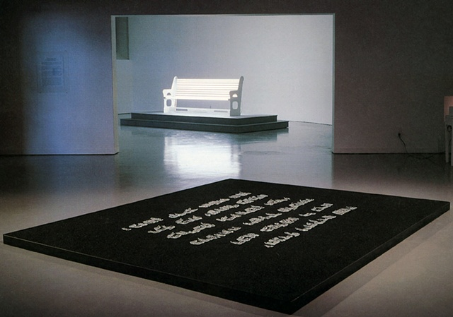 Chorus presents the first section of the Jewish prayer for mourning in crystal letters on a bed of black sand