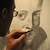 B. Rodriguez working on a graphite drawing