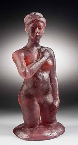 kiln cast glass figure in transparent red glass, embellished with a black ink wipe
