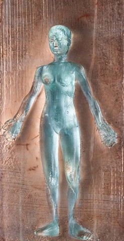 glass bas relief of woman in gesture of generosity