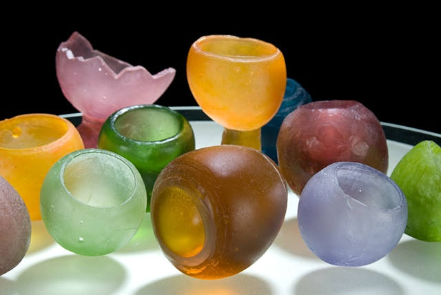 cast glass egg shapes of different sizes and colors