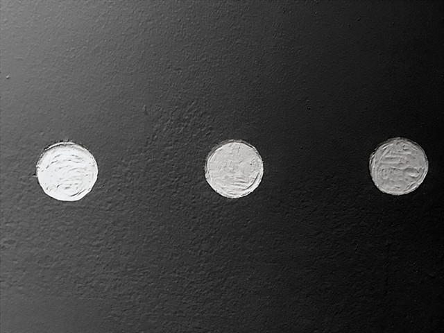 Engraved punctuation marks on the gallery wall