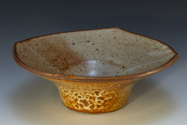 flared top bowl in stoneware. shino glazes