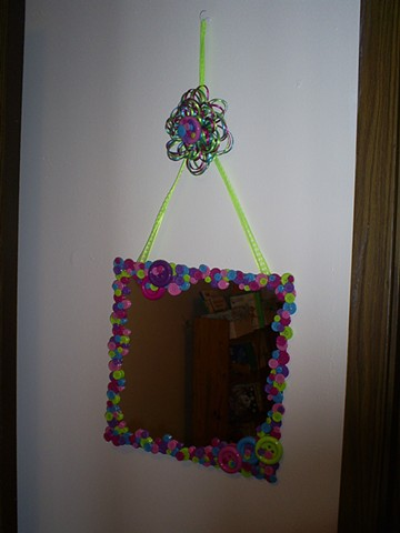 button framed mirror by ashley seaman