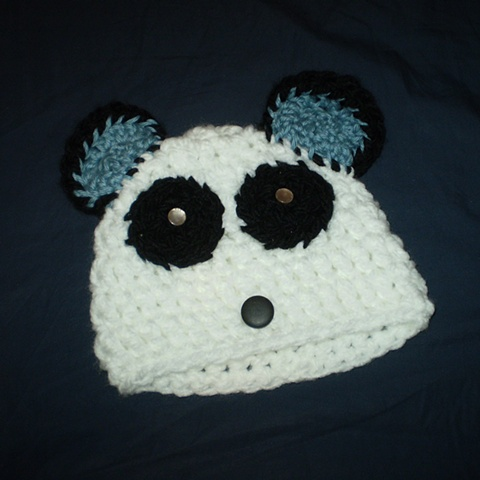 hand-crocheted panda baby hat