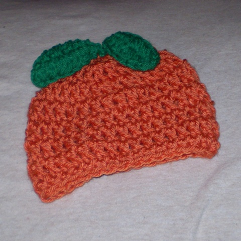 hand-crocheted orange crocheted hat