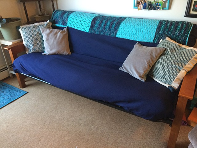 Futon with pillows