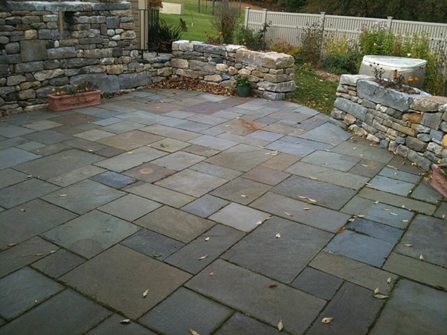 fieldstone walls with custom granite planters and bluestone patio