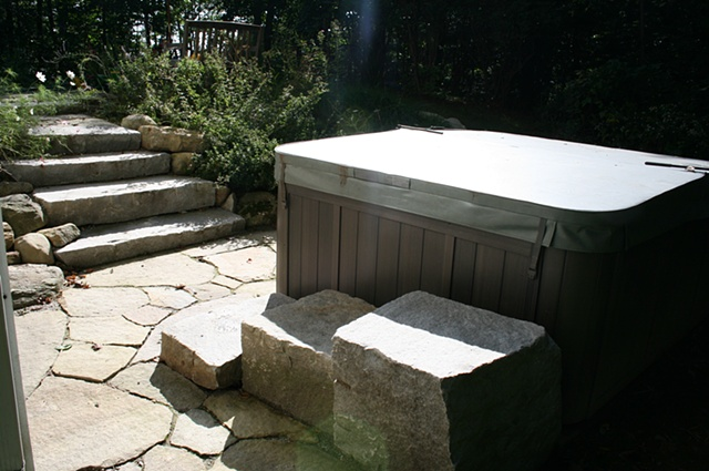 granite steps and paving surrounding hot tub