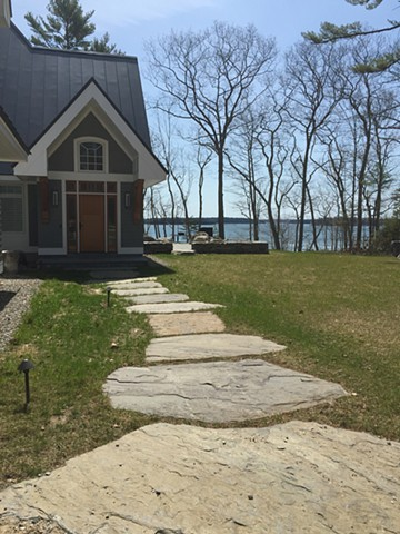 Giant heritage valley stepping stones welcome you to the entrance of this sea side home.
