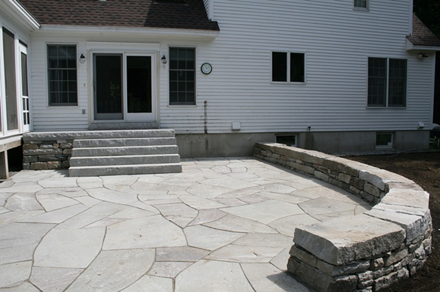 blue stone patio with sitting wall and steps with 12'x4'cantaleavered top landing