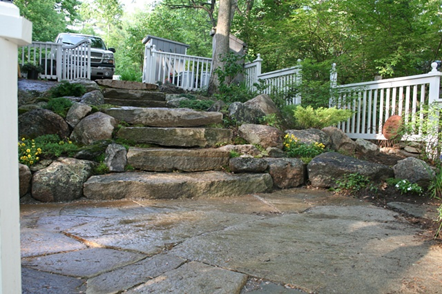 weathered granite steps with boulder walls.
