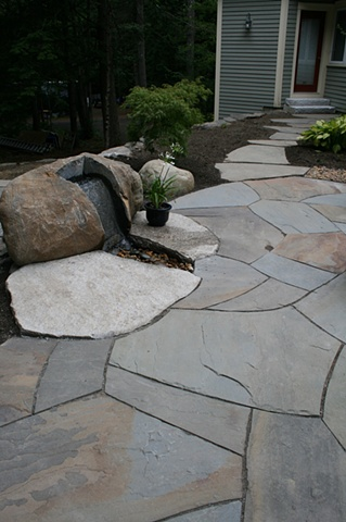 irregular bluestone patio with boulder fountain and bluestone walkway, granite steps