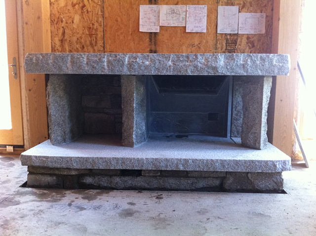 inside fireplace, granite with inlaid soapstone fire box