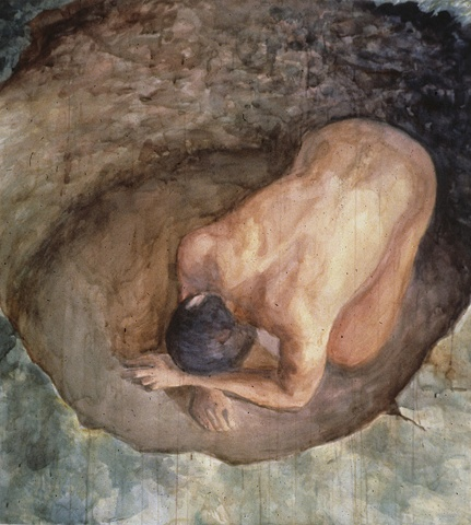 kneeling male figure in a hole seen from above