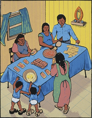 family at a table making tamales