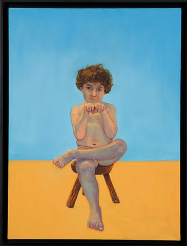 young boy sitting on wooden stool looking at viewer with fists raised facing viewer