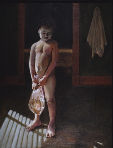 small nude boy holding a goldfish in a bag