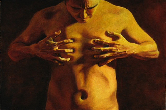 Torso view of a nude man with hands on chest