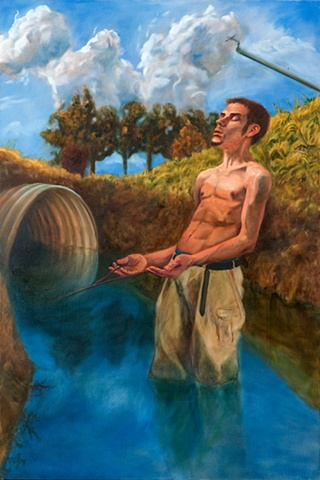 shirtless young man stands in an irrigation ditch with eyes closed holding a dowser's rod