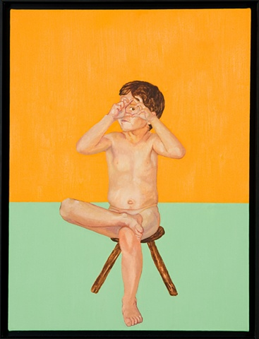 young boy sitting on wooden stool looking at viewer through fingers