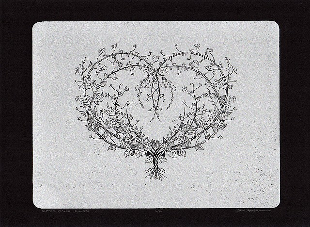 heart made of branches on a silver background
