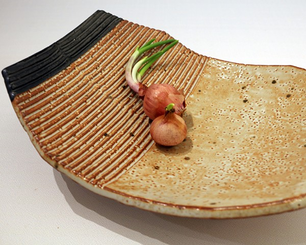 Textured stoneware bowl with applied decoration and glazed with shino and iron oxide
