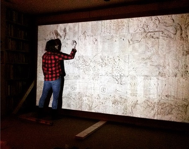 Projecting and tracing my drawing onto the panels to be carved