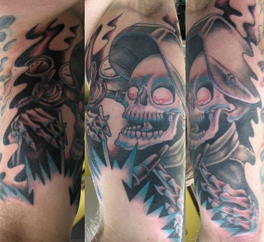 Peter McLeod Tattoo Welding skull tattoo