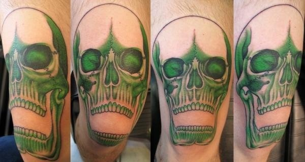 Peter McLeod Tattoo green skull tattoo