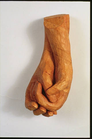 Wood sculpture of hands by Lin Lisberger