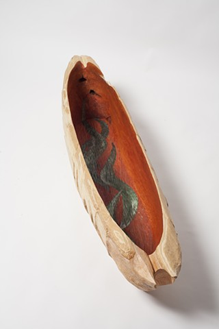 Carved cedar boat sculpture by Lin Lisberger