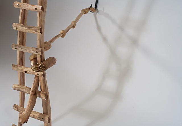 Wood sculpture of ladder and knots by Lin Lisberger